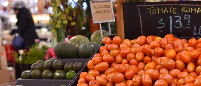 Fresh tomatoes and other produce in a market